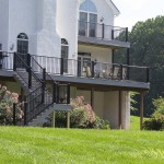 two story outdoor deck with black vinyl railing