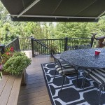 wooden deck surrounded by black vinyl railing