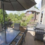outdoor clubhouse deck with grill and patio furniture