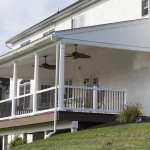 white column and railings attached house deck