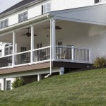 yard view of attached covered deck with railing
