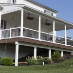 new covered porch with columns and white railing