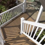 clubhouse deck staircase with white vinyl railing