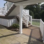 clubhouse house deck staircase with white vinyl railing