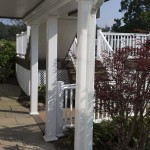 white downspout and gutter below two story deck