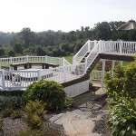 two story attached deck leading to detached patio deck