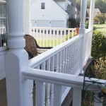 white oxford post balusters around clubhouse deck porch