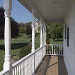 white oxford railing and post balusters around clubhouse porch