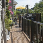 small attached clubhouse deck with black aluminum railing