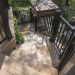 clubhouse deck staircase with black railing