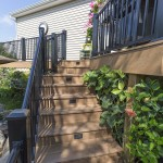 clubhouse deck staircase with lighting and aluminum railing