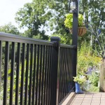 hanging plant and lights attached to deck railing