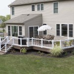 new outdoor deck with white vinyl railing