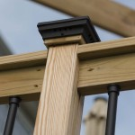 wooden railing with black post cap