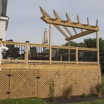 attached wooden deck and pergola