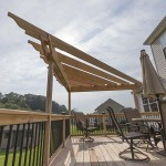 side shot of attached pergola and wood deck railing
