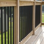 black balusters connected by wooden railing
