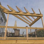 attached pergola on wooden deck