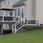 outdoor deck staircase with white vinyl railing