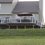 outdoor two story deck with white vinyl railing
