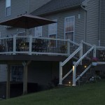 two story deck with white vinyl railings