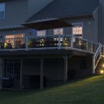 deck staircase and walkway leading to two story deck