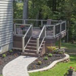 custom azek deck with vinyl railing and stone walk way leading to it
