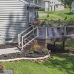 side view of azek custom deck with stairs and railing