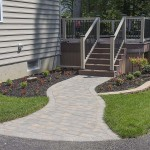 stone walkway leading to outdoor azek deck