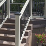 close up of tan vinyl railing with black trims leading to outdoor deck