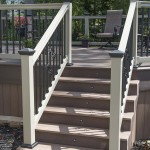 close up of deck staircase with tan vinyl railing