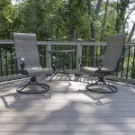 two patio chairs and table on custom vinyl deck