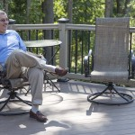 man sitting on vinyl outdoor deck