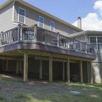 side ground view of outdoor custom porch deck