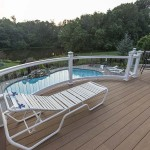 two story home deck above inground pool