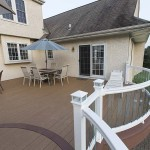 azek deck with curved white vinyl railing