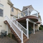 decking staircase with white vinyl railing