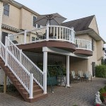 large two story deck with white vinyl railing