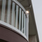 circular railing with clear post balusters and post cap lights