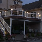two story custom deck at night