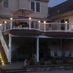 two story attached deck at night