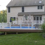 wolf decking pool patio with white vinyl fence around it
