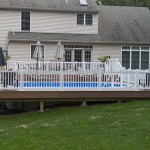 close up of white vinyl fence around pool deck