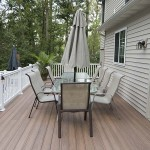 faux wood deck with patio table in center of it