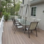 side view of faux wood deck with patio table in the middle