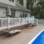 two story wolf deck with white vinyl fencing