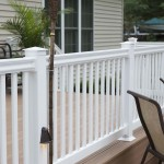 white vinyl railing on second story of wolf deck