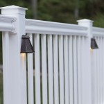 close up of white vinyl railing and copper lights