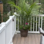 white vinyl fencing with planter on wolf deck