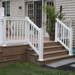 side view of wolf decking stairs and white vinyl pool door